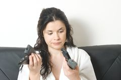 Woman with remote controls stock images