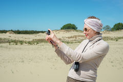 Woman remove a camera on vacation Royalty Free Stock Images