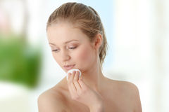 Woman remove her make-up Stock Image