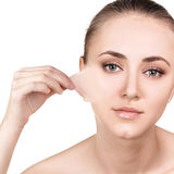 Woman remove her old dry skin from face. Stock Photography