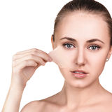 Woman remove her old dry skin from face. Stock Photo