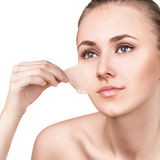 Woman remove her old dry skin from face. Stock Photos