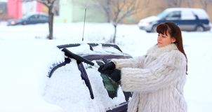 Woman remove snow Royalty Free Stock Image