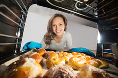 Woman Removing Bun View From Inside The Oven Royalty Free Stock Photography