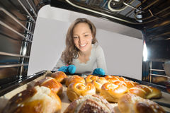 Woman Removing Bun View From Inside The Oven Royalty Free Stock Photo