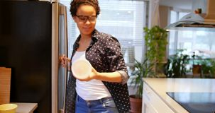 Woman removing can food from refrigerator 4k