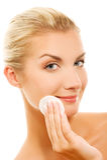 Woman removing cosmetics Stock Photo