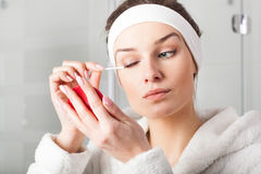 Woman removing eyes make-up Royalty Free Stock Images