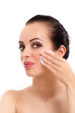 Woman removing face makeup with cotton swab pad royalty free stock photo