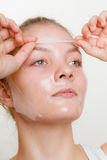 Woman removing facial peel off mask. Stock Photography