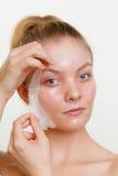 Woman removing facial peel off mask. Royalty Free Stock Photos