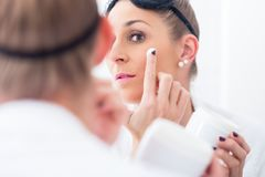 Woman removing her makeup before sleeping Stock Photos