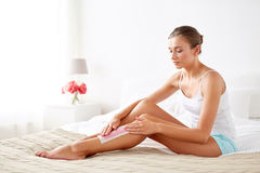 Woman removing leg hair with depilatory wax strip Royalty Free Stock Photography