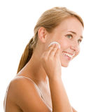 Woman removing make-up Royalty Free Stock Image