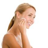 Woman removing make-up Royalty Free Stock Image