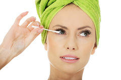 Woman removing make up with cotton bud. Stock Image