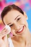 Woman removing make up Stock Photos
