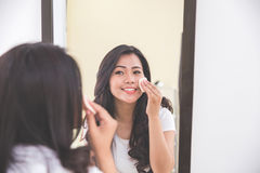 Woman removing make up from her face Royalty Free Stock Images
