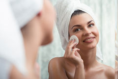 Woman removing make-up Stock Images