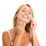 Woman removing makeup Royalty Free Stock Image