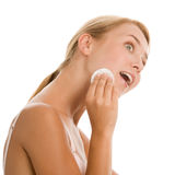 Woman removing makeup royalty free stock photo