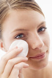 Woman removing makeup Royalty Free Stock Photography
