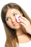 Woman removing makeup Royalty Free Stock Images