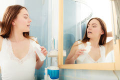 Woman removing makeup with cotton swab pad. Royalty Free Stock Images