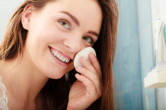Woman removing makeup with cotton swab pad. Stock Photo
