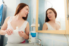 Woman removing makeup with cotton swab pad. Stock Image