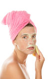 Woman removing mask royalty free stock image