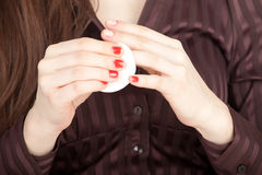 Woman removing red varnish Royalty Free Stock Photo