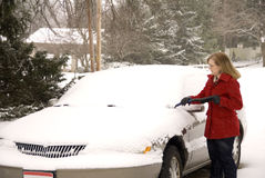 Woman Removing Snow From Car 1 Stock Photography