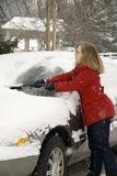 Woman Removing Snow From Car 10 Royalty Free Stock Photography