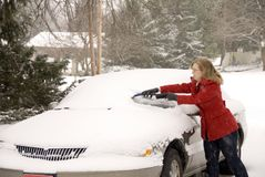 Woman Removing Snow From Car 2 Stock Image