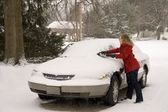 Woman Removing Snow From Car 3 Stock Photo