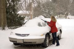 Woman Removing Snow From Car 4 Royalty Free Stock Photos