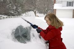 Woman Removing Snow From Car 5 Royalty Free Stock Photo