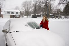 Woman Removing Snow From Car 7 Royalty Free Stock Image