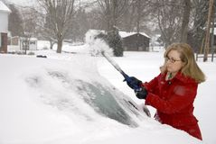 Woman Removing Snow From Car 8 Stock Images
