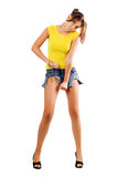 Woman rending her shorts Stock Images