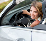 Woman renting a car Stock Images