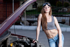 Woman repair car Royalty Free Stock Photography