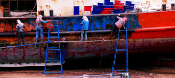 Woman repair old ship. In Xiapu,fujian province of China, there loacated a small old ship repair factory, this picture showed 5 woman remove the rust of the iron Stock Photography
