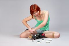 Woman repair roller-skates Stock Photography