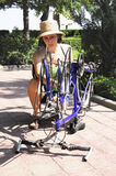 Woman repairing bike Stock Images