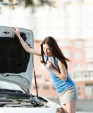 Woman repairing the broken cabriolet on the road Royalty Free Stock Image