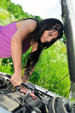 Woman repairing broken car Stock Photos