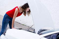 Woman repairing car. Failure outside Stock Image
