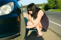 Woman repairing the car Royalty Free Stock Photo